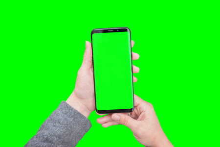 Round and curved edge smart phone in woman hands. Chroma key isolated for video editors.