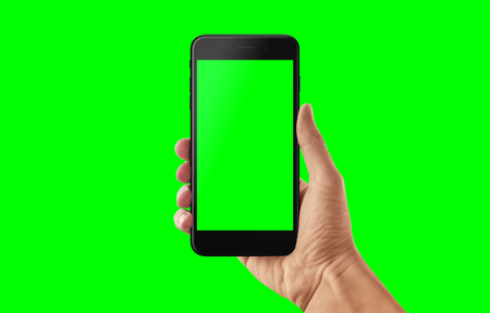 Isolated smart phone and hand in green, chroma key. Video app presentation mockup.