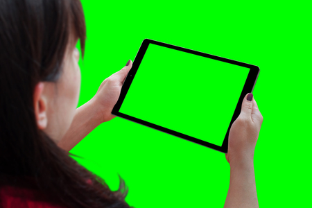 Woman holding tablet with isolated screen in horizontal position. Isolated in green, chroma key.