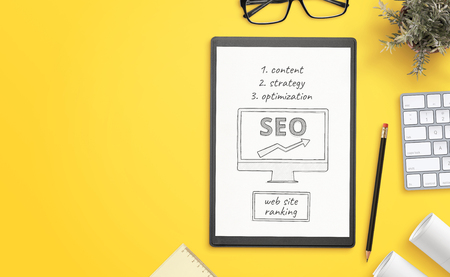 Search engine optimization goals sketch on paper. Office desk with copy space beside. Hero, header image. Фото со стока - 119207101