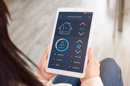 Smart home control app on tablet display. Close-up. Stock Photo