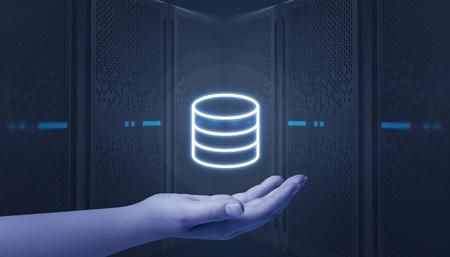 Hand holding server, data center icon. Web hosting servers in background. Stock Photo