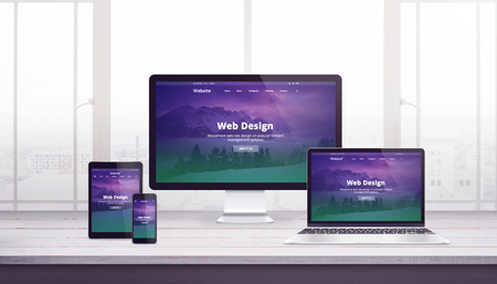 Responsive web site concept on multiple devices. Work desk with window in background. Modern flat web design with purple green page concept.