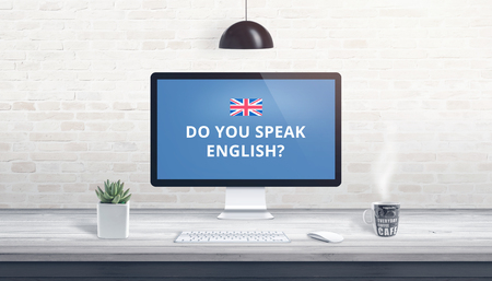 Concept of English language learning online. Question Do you speak English on a computer display on work desk. Banco de Imagens