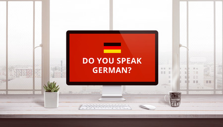 Do you speak German on computer display with a flag of Germany. Online study, lessons concept. Banco de Imagens - 119999373