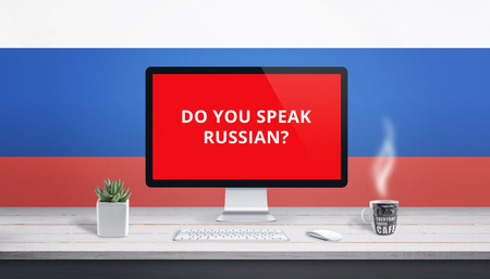 Concept of studying Russian language online wih question Do you speak Russian on computer display, and Russian flag in background.
