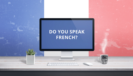 French lessons online. Concept teaching language online with text Do you speak French on computer display. Banco de Imagens