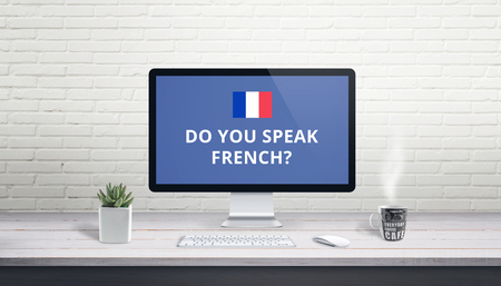 Concept of French language learning online. Question Do you speak French wih French flag on a computer display on work desk. Banco de Imagens - 119999377