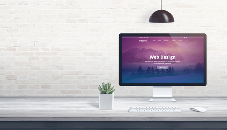 Modern theme on computer display. Professional studio concept with free space on wall for text. Stock Photo