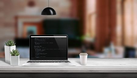Web development studio concept. Laptop vith script code editor. Copy space beside.