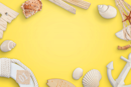 Summer, sea, travel concept with shells on yellow table. Stock Photo