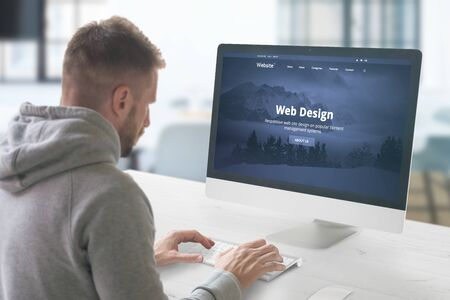 Web design studio concept with man and computer display with modern web site presentation. Imagens