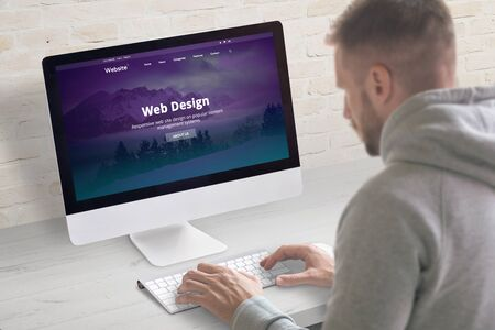 The guy works on the website design in the office.