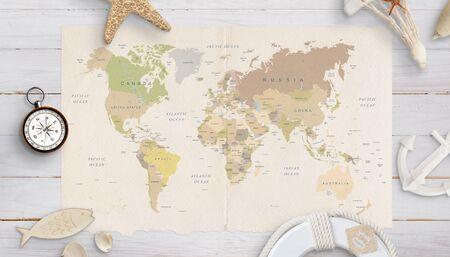Weltkarte auf einem Tisch, umgeben von Muscheln, Kompass, Anker und Rettungsring. Das Konzept der Urlaubsplanung in fernen Ländern. Standard-Bild