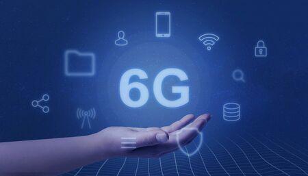 6G netork levitate in woman hand. Speed mobile network concept. Banco de Imagens - 126884345