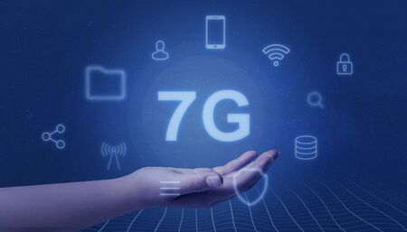 Seven generation of mobile network concept. Hand showing 7G surrounded by service icons. Imagens
