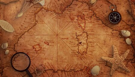 Old treasure map concept. Magnifier, compass and sea decorations on the map. Top view. Stock Photo