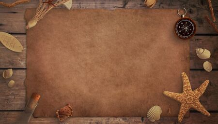 A piece of old paper on a wooden table, surrounded by old sea things. Top view, flat lay, mockup. Stock Photo