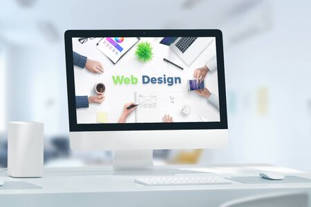 Web, app design studio concept with computer display and web design text. Concept of web team office. 免版税图像