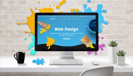 Web design concept. Modern web site on computer display surrounded by brush color drops. Stock Photo
