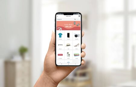 Discount ad on store app concept. Woman holding smartphone and shopping online. Close-up.