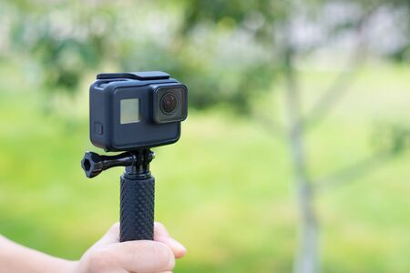 Action camera on a stick from the front. Close-up.