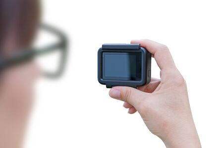 Woman holding action camera isolated, close-up. Banco de Imagens - 129312611