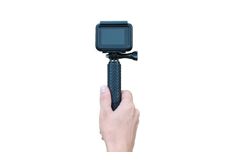 Action camera on stick in hand isolated in white. Blank screen for mockup.