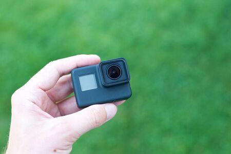 Small action camera ih hand close-up.