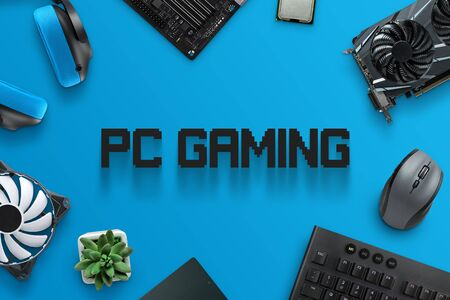 PC gaming text surrounded with gaming computer components. Stock Photo