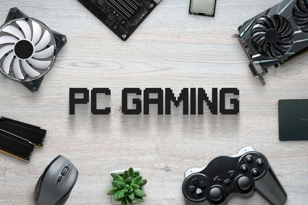 PC gaming flat lay scene with text and gaming computer components and joypad. Top view, close up composition.