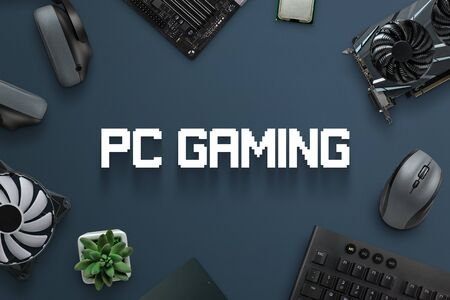 PC gaming concept scene with text and gaming computer components. Top view, flat lay, close-up. Stockfoto