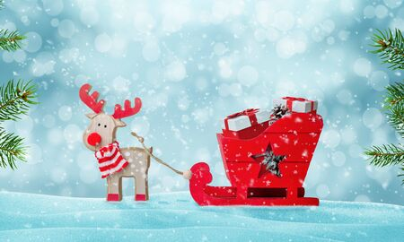 Santa's sleigh full of gifts in snow. Deer pulls the sled. Cute wooden toy. Christmas tree beside. Copy space above.