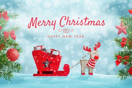 Santa's reindeer sleigh full of gifts in snow. Merry Christmas greeting card with cute toys composition. Christmas tree with decorations beside.