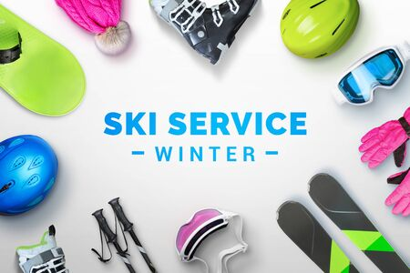 Ski service winter text surrounded by ski and snowboard equipment. Top view, flat lay Standard-Bild