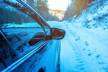 Car rearview mirror on the move. Winter vacation travel concept