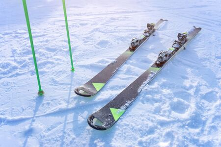 Skis and poles for the race on the slope. The concept of sports and recreational skiing