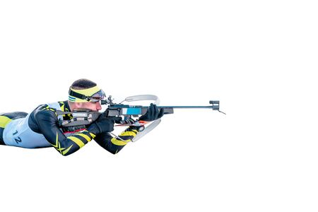 Isolated biathlon skier with rifle in shooting prone position Stock Photo