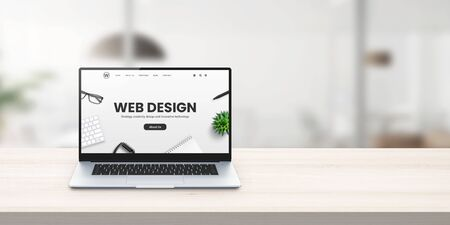 Web design studio promo web site on laptop display on office desk concept Stok Fotoğraf