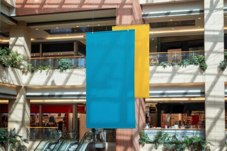 Two empty clean banners hanged inside the shopping mall. Copy space for promo text or logo promotion