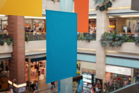 Clean, empty banners hanged inside the shopping mall. Brand promotion, mockup Stok Fotoğraf