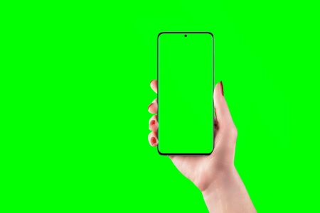 Phone mockup in woman hand with isolated screen and background in chroma key green Stok Fotoğraf