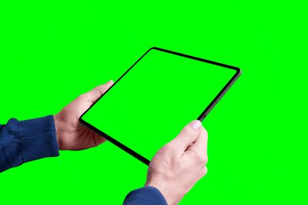 Tablet mockup in man hands isolated in chroma key green