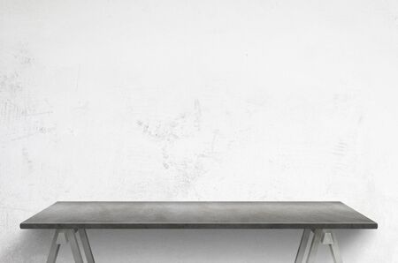 Clean gray table front of white concrete wall