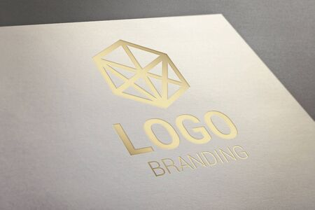Gold logo presentation on white paper. Concept of company, visual identity, branding promotion