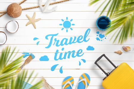 Travel time composition with painted text on white wooden floor, surrounded by travel bag, slippers, shells, map, coconuts,  starfish, lifebelt, anchor
