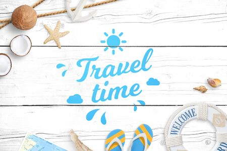Travel time painted on white wooden surface. Summer travel composition