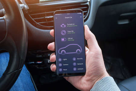 Car status information on the mobile app. Flat app design concept. Phone placed on the car seat