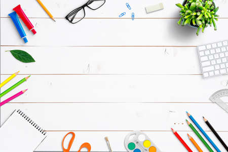School supplies on white wooden desk. Top view, flat lay composition with copy space in the middle Stok Fotoğraf