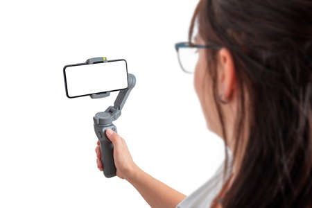 Woman holding gimbal with smart phone. Isolated background and display for mockup.